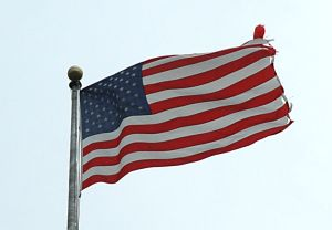 Tattered U.S. Flag above the Canon House Office Building